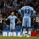 Manchester City's Pablo Zabaleta (5) reacts as Roma players celebrate the goal of Francesco Totti during a Champions League group E soccer match between Manchester City and Roma at the Etihad Stadium, Manchester, England, Tuesday, Sept. 30, 2014