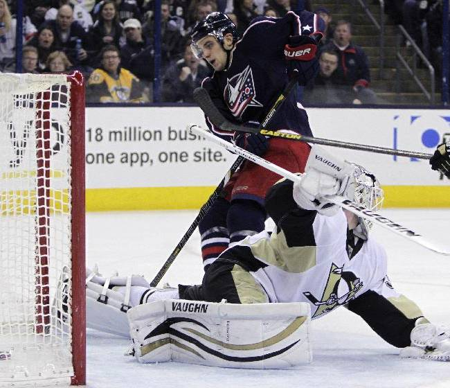Columbus Blue Jackets' Corey Tropp, top, scores a goal against Pittsburgh Penguins' Jeff Zatkoff during the second period of an NHL hockey game on Sunday, Dec. 29, 2013, in Columbus, Ohio