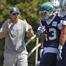 In this May 16, 2014, file photo, Dallas Cowboys defensive coordinator Rod Marinelli instructs players during a rookie minicamp at the Cowboys' headquarters in Irving, Texas. Marinelli loved his 0-16 season when he was the head coach in Detroit. He loved