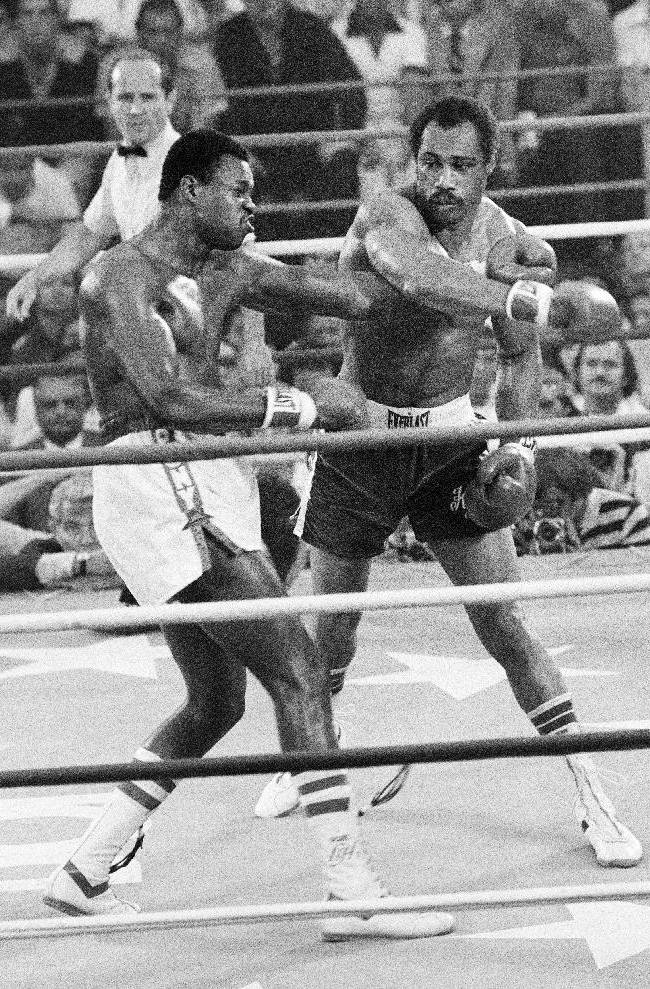 In this June 9, 1978, file photo, Ken Norton, right, follows through with his right as Larry Holmes misses during an early round of their heavyweight championship fight in Las Vegas. Norton, a former heavyweight champion, has died, his son said, Wednesday, Sept. 18, 2013. He was 70