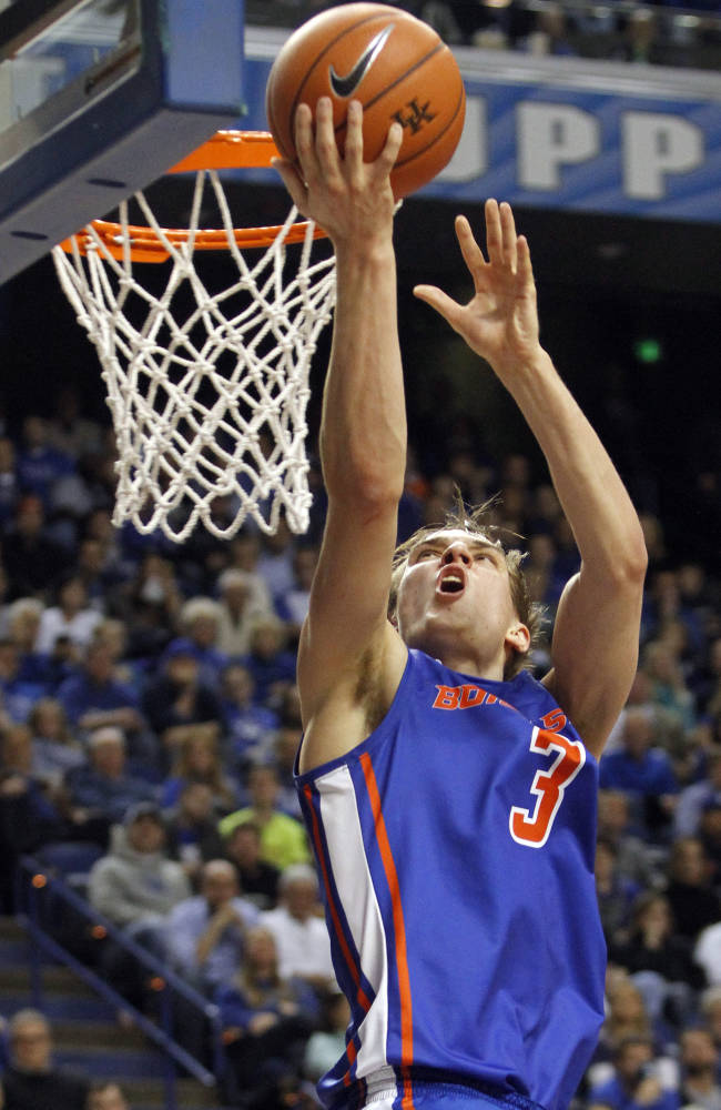 Boise State's Anthony Drmic takes a shot during the second half of an NCAA college basketball game against Kentucky, Tuesday, Dec. 10, 2013, in Lexington, Ky. Kentucky won 70-55