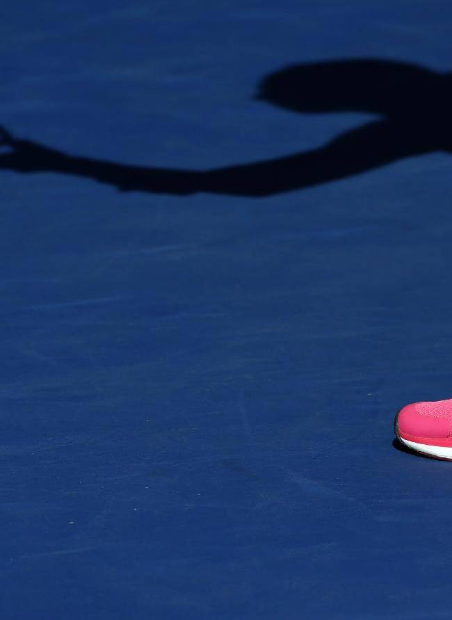 Marin Draganja, of Croatia, casts a shadow during a first round mixed doubles match at the U.S. Open tennis tournament Friday, Aug. 29, 2014, in New York