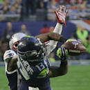 Seattle Seahawks wide receiver Chris Matthews (13) catches a pass in front of New England Patriots cornerback Kyle Arrington during the first half of NFL Super Bowl XLIX football game Sunday, Feb. 1, 2015, in Glendale, Ariz The Associated Press