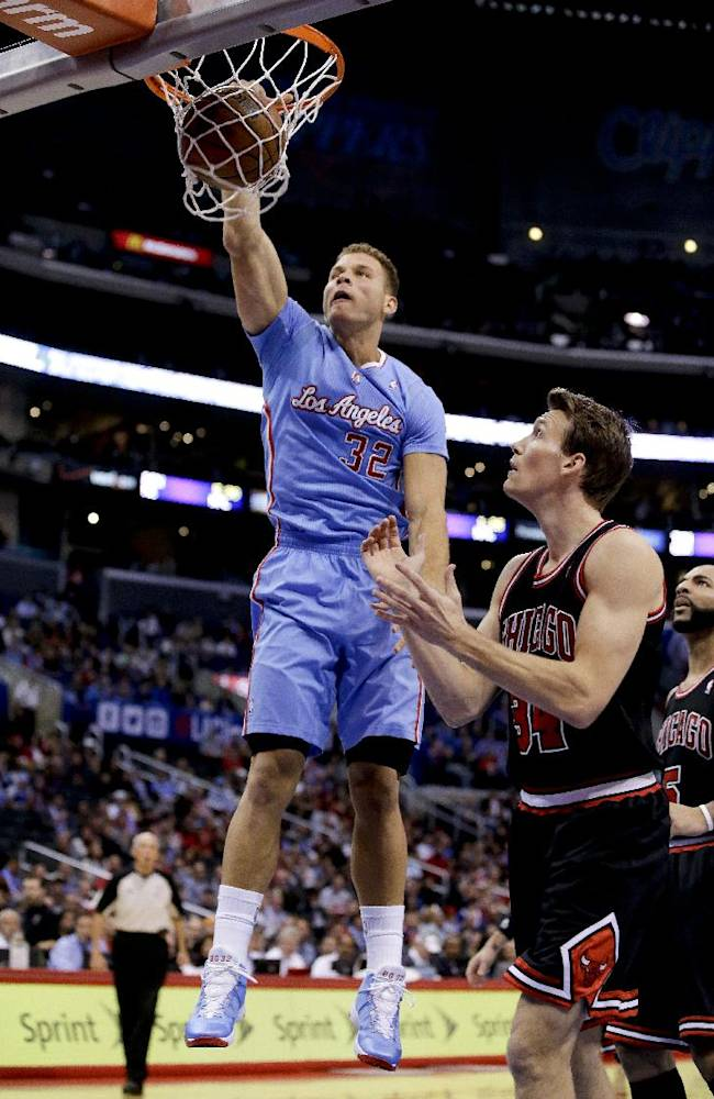 Los Angeles Clippers forward Blake Griffin, left, dunks as Chicago Bulls forward Mike Dunleavy looks on during the first half of an NBA basketball game in Los Angeles, Sunday, Nov. 24, 2013