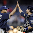 Milwaukee Brewers' Francisco Rodriguez (57) celebrates with Jonathan Lucroy at the end of a baseball game against the Philadelphia Phillies on Thursday, April 10, 2014, in Philadelphia. The Brewers won 6-2 The Associated Press