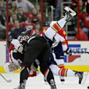 Carolina Hurricanes' Brett Bellemore throws Florida Panthers' Erik Gudbranson to the ice during a fight in the second period of an NHL hockey game in Raleigh, N.C., Friday, Feb. 7, 2014 The Associated Press