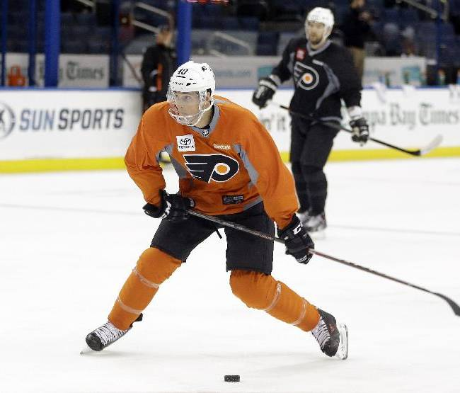 Philadelphia Flyers center Vincent Lecavalier takes a slapshot during a team practice Tuesday, Nov. 26, 2013, in Tampa, Fla. Lecavalier played for the Tampa Bay Lightning for 14 seasons.  Lecavalier is playing in his first game in Tampa on Wednesday night since leaving the team.  He signed with the Flyers when the Lightning bought out his contract during the off-season