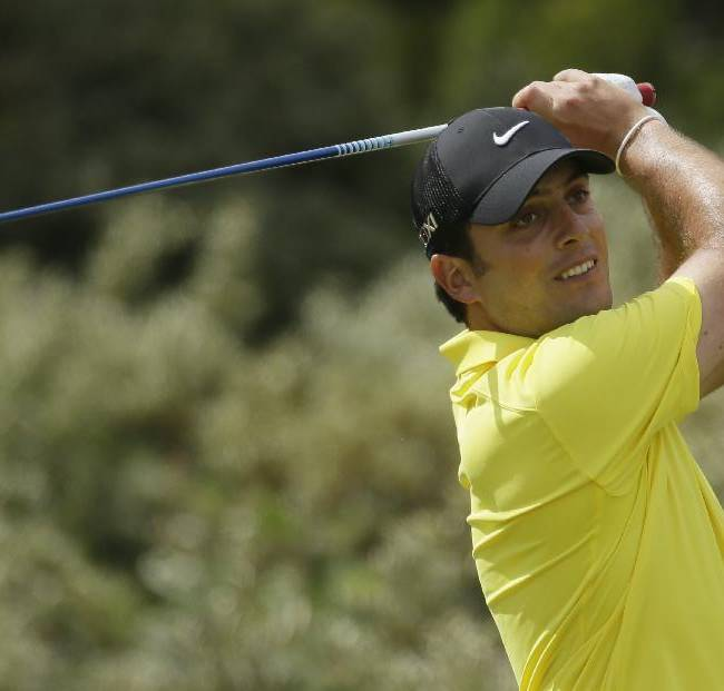 Francesco Molinari of Italy drives off the third tee during the final round of the British Open Golf Championship at Muirfield, Scotland, Sunday July 21, 2013