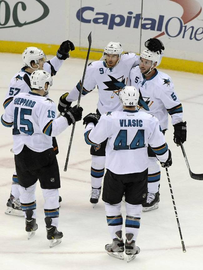 San Jose Sharks' Martin Havlat (9) celebrates his goal against the New York Islanders with James Sheppard (15), Tommy Wingels (57), Jason Demers (5) and Marc-Edouard Vlasic (44) in the second period of an NHL hockey game on Friday, March 14, 2014, in Uniondale, N.Y. Demers also scored during the Sharks 4-3 win