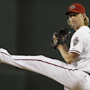 Arizona Diamondbacks' Bronson Arroyo winds up to throw a warmup pitch prior to the first inning of a baseball game against the Houston Astros on Tuesday, June 10, 2014, in Phoenix The Associated Press