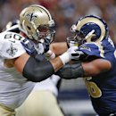 St. Louis Rams defensive end Michael Sam, right, goes up against New Orleans Saints tackle Thomas Welch (60) during the first quarter of a preseason NFL football game Friday, Aug. 8, 2014, in St. Louis The Associated Press