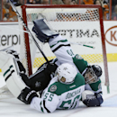 Dallas Stars' Sergei Gonchar (55), of Russia, collides with goalie Tim Thomas (30) during the second period of an NHL hockey game against the Philadelphia Flyers, Thursday, March 20, 2014, in Philadelphia The Associated Press