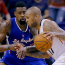 Los Angeles Clippers' DeAndre Jordan defends as Phoenix Suns' P.J. Tucker, right, drives during the first half of an NBA basketball game, Tuesday, March 4, 2014, in Phoenix The Associated Press