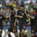 Mexico's Raul Jimenez (9) celebrates with teammates Marco Fabian (10), Juan Carlos Valenzuela (18) and Efrain Velarde (15) after Jimenez scored a goal against Canada in the first half of a CONCACAF Gold Cup soccer match Thursday, July 11, 2013, in Seattle. (AP Photo/Ted S. Warren)