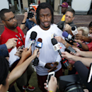 Washington Redskins quarterback Robert Griffin III, center, speaks during a media availability after practice at the team's NFL football training facility, Sunday, July 27, 2014, in Richmond, Va The Associated Press