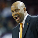 Tennessee basketball coach Cuonzo Martin calls out to his players in the second half of an NCAA college basketball game against Mississippi State in Starkville, Miss., Wednesday, Feb. 26, 2014. Tennessee won 75-68. (AP Photo/Rogelio V. Solis)