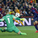 Barcelona's Luis Suarez attempts to score past Manchester City's goalkeeper Joe Hart during a Champions League round of 16 second leg, soccer match between FC Barcelona and Manchester City at Camp Nou stadium, in Barcelona, Spain, Wednesday, March 18, 201