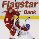 Detroit Red Wings left wing Justin Abdelkader (8) checks Montreal Canadiens right wing Brandon Prust (8) in the third period of an NHL hockey game in Detroit Sunday, Nov. 16, 2014 The Associated Press