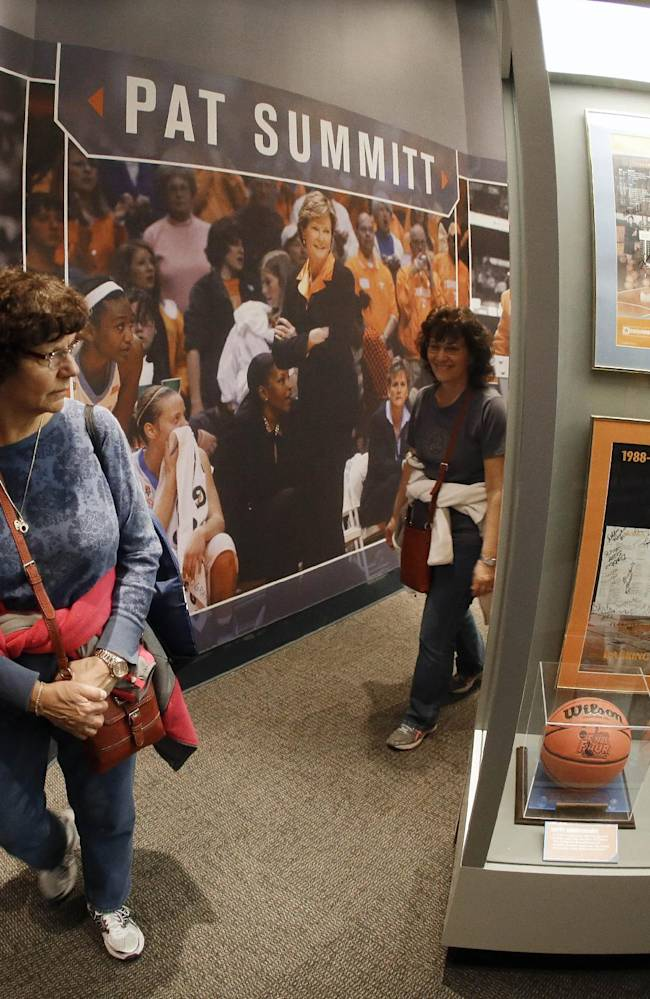 Mary Ann McElhiney, left, of East Hartford, Conn., tours the Pat Summitt Gallery at the Tennessee Sports Hall of Fame on the opening day of the exhibit Friday, April 4, 2014, in Nashville, Tenn. The exhibit, located in Bridgestone Arena, features memorabilia, photos, videos and interactive displays highlighting the former Tennessee women's NCAA college basketball coach