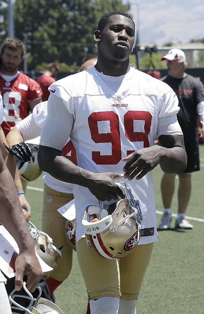San Francisco 49ers linebacker Aldon Smith (99) walks off the practice field during NFL football minicamp in Santa Clara, Calif., Thursday, June 19, 2014