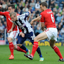 West Brom's Matej Vydra, centre, is held by Cardiff's Ben Turner, right, and Andrew Taylor during the English Premier League soccer match between West Bromwich Albion and Cardiff City at Hawthorns Stadium in West Bromwich, England, Saturday, March 29 20
