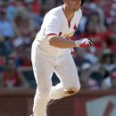 St. Louis Cardinals' Matt Holliday heads to first on an RBI double during the eighth inning of a baseball game against the Kansas City Royals on Saturday, June 16, 2012, in St. Louis. Holliday homered and drove in five runs in the Cardinals' 10-7 victory. (AP Photo/Jeff Roberson)