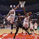 Indiana Pacers forward Paul George (24) shoots between Chicago Bulls center Joakim Noah (13) and Jimmy Butler (21) during the first half of an NBA basketball game Monday, March 24, 2014, in Chicago The Associated Press