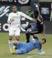 Los Angeles Galaxy goalie Jaime Penedo, bottom, collides with teammate Kofi Opare, right, and Portland Timbers forward Ryan Johnson during the second half of an MLS soccer game in Portland, Ore., Sunday, Sept. 29, 2013. The Timbers won 1-0. (AP Photo/Don Ryan)