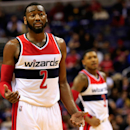 WASHINGTON, DC - DECEMBER 16: John Wall #2 of the Washington Wizards gestures while talking with teammates during the second half against the Minnesota Timberwolves at Verizon Center on December 16, 2014 in Washington, DC. (Photo by Rob Carr/Getty Images)