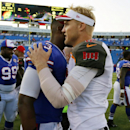 Tampa Bay Buccaneers quarterback Josh McCown (12) talks to Buffalo Bills' EJ Manuel (3) after a preseason NFL football game Saturday, Aug. 23, 2014, in Orchard Park, N.Y. The Buccaneers won the game 27-14 The Associated Press