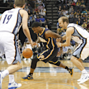 Memphis Grizzlies guards Nick Calathes, right, and Beno Udrih (19), of Slovenia, try to contain Indiana Pacers forward Solomon Hill, center, in the second half of an NBA basketball game on Saturday, March 22, 2014, in Memphis, Tenn. The Grizzlies won 82-7