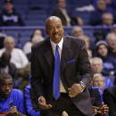 FILE - In this Nov. 13, 2013 file photo, DePaul head coach Oliver Purnell reacts as he watches his team play Southern Mississippi in an NCAA college basketball game in Rosemont, Ill. No matter how bad DePaul has been in recent years, Purnell can envision the Blue Demons winning the Big East. They went 12-21 and finished last in the Big East at 3-15 a year ago. But Purnell insists they're ready to make a jump with Big East Rookie of the Year Bill Garrett Jr. and the 6-foot-11 Tommy Hamilton IV leading the way. (AP Photo/Nam Y. Huh)