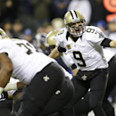 New Orleans Saints quarterback Drew Brees calls to his team before a taking a snap in the first half of an NFL football game against the Seattle Seahawks, Monday, Dec. 2, 2013, in Seattle The Associated Press
