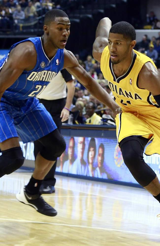 Indiana Pacers forward Paul George, right, works his way past Orlando Magic forward Maurice Harkless in the second half of an NBA basketball game in Indianapolis, Tuesday, Oct. 29, 2013. Indiana won 97-87