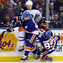New York Islanders defenseman Nick Leddy (2) checks Winnipeg Jets center Mark Scheifele (55) as New York Islanders left wing Cory Conacher (89) is tripped up in the first period of an NHL hockey game in Uniondale, N.Y., Tuesday, Oct. 28, 2014 The Associat