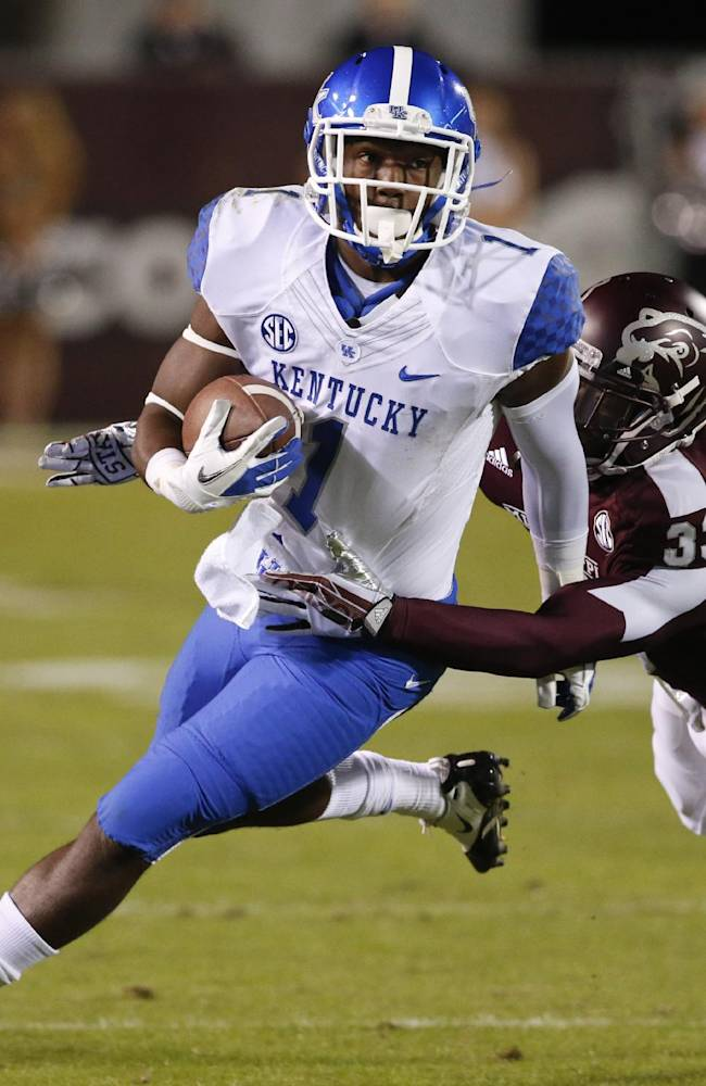 Kentucky running back Ryan Timmons (1) breaks a tackle by Mississippi State defensive back Kivon Coman (33) in the second half of their NCAA college football game at Davis Wade Stadium in Starkville, Miss., Thursday, Oct. 24, 2013. Mississippi State won 28-22