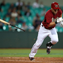 The Arizona Diamondbacks' Cliff Pennington runs toward first after a dropped third strike and is thrown out during their exhibition baseball game against Team Australia at the Sydney Cricket ground in Sydney, Friday, March 21, 2014. Australia won the game