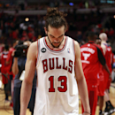 Chicago Bulls center Joakim Noah walks off the court after a 75-69 loss to the Washington Wizards in Game 5 of an opening-round NBA basketball playoff series Tuesday, April 29, 2014, in Chicago. (AP Photo/Charles Rex Arbogast)