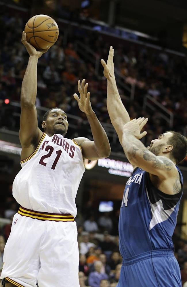 Cleveland Cavaliers' Andrew Bynum (21) shoots over Minnesota Timberwolves' Nikola Pekovic, from Montenegro, in the third quarter of an NBA basketball game Monday, Nov. 4, 2013, in Cleveland. Bynum scored 10 points off the bench in Cleveland's 93-92 win