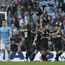 Man City ousted from FA Cup, Madrid rolls in Spain
