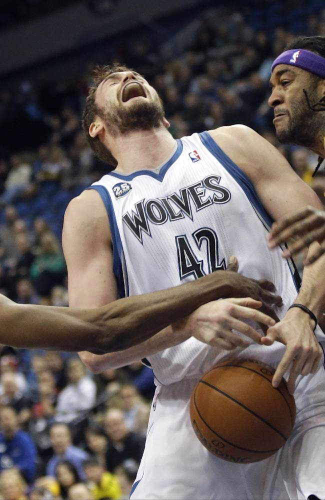 Minnesota Timberwolves' Kevin Love, center, loses the ball as he is fouled by Los Angeles Lakers' Nick Young, left, as Young and Jordan Hill defend during the first quarter of an NBA basketball game, Tuesday, Feb. 4, 2014, in Minneapolis