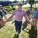 Hunter Mahan of the U.S. greets fans as he walks off the eighteenth green at the Canadian Open golf tournament at the Glen Abbey Golf Club in Oakville, July 26, 2013. REUTERS/Fred Thornhill