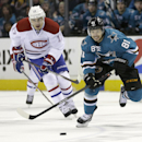 San Jose Sharks center Tyler Kennedy (81) battles for the puck against Montreal Canadiens left wing Rene Bourque (17) during the first period of an NHL hockey game on Tuesday, March 8, 2014, in San Jose, Calif The Associated Press
