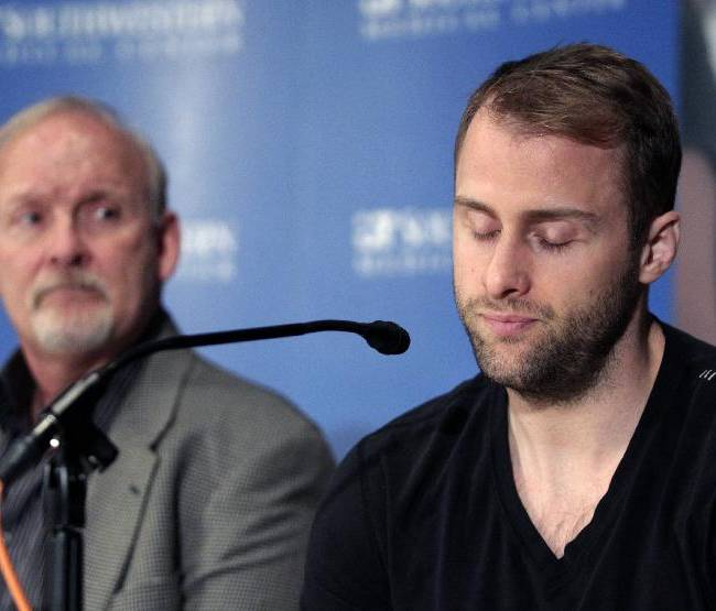 Dallas Stars forward Rich Peverley, right, makes a statement regarding his health and the incident which occurred in a recent NHL game during a news conference at UT Southwestern Medical Center as coach Lindy Ruff looks on Wednesday, March 13, 2014, in Dallas
