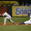 Philadelphia Phillies second baseman Chase Utley (26) stretches to force out Texas Rangers' Shin-Soo Choo (17) on a ball hit by Rangers' Elvis Andrus during the sixth inning of a baseball game, Wednesday, April 2, 2014, in Arlington, Texas. Andrus was saf