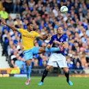 Crystal Palace's Fraizer Campbell, left, and Everton's Phil Jagielka battle for the ball during their English Premier League soccer match at Goodison Park, Liverpool, England, Sunday, Sept. 21, 2014