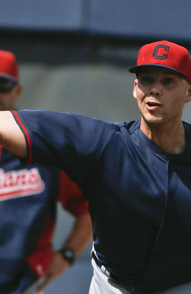 Cleveland Indians' Justin Masterson throws a bullpen session as pitching coach Mickey Callaway watches before a spring rxhibition baseball game on Friday, March 28, 2014, in San Diego