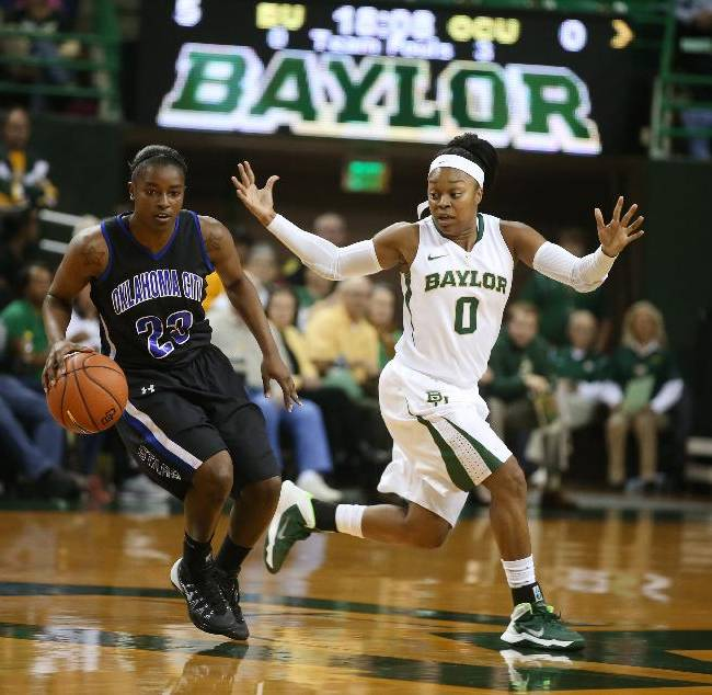 Baylor Odyssey Sims, right, guards Oklahoma City Markeisha Johnson during the first half of an NCAA college basketball exhibition game, Tuesday, Nov. 5, 2013, in Waco, Texas