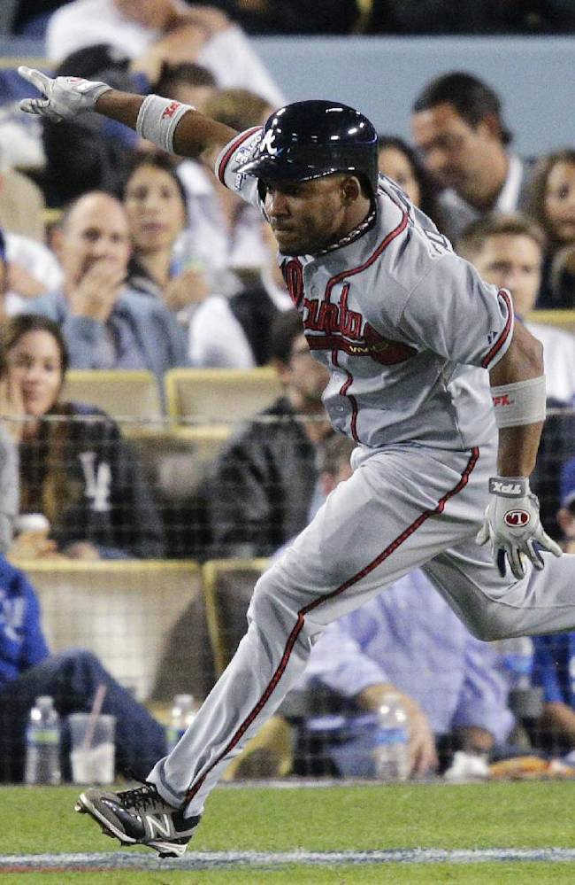 Atlanta Braves' Jose Constanza runs to first base after he hit an RBI single to score Elliot Johnson in the seventh inning of Game 4 in the National League baseball division series against the Los Angeles Dodgers, Monday, Oct. 7, 2013, in Los Angeles