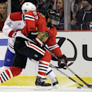 Chicago Blackhawks defenseman Johnny Oduya (27) battles for the puck against Montreal Canadiens center Tomas Plekanec (14) during the first period of an NHL hockey game in Chicago, Friday, Dec. 5, 2014 The Associated Press